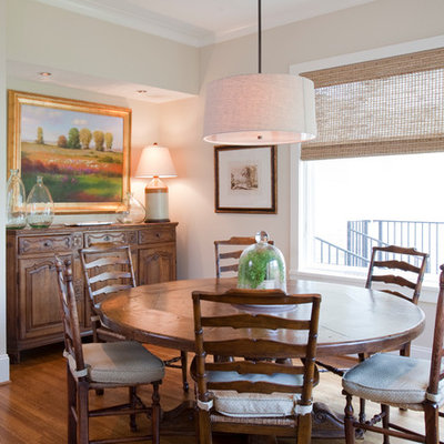 Example of a large classic medium tone wood floor kitchen/dining room combo design in Houston with beige walls