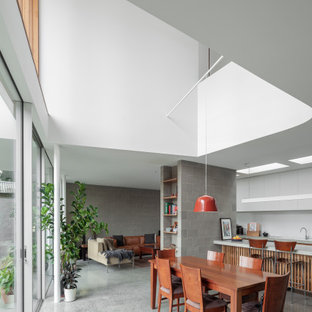 This is an example of a contemporary dining room in Melbourne.
