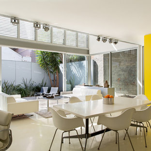 Photo of a contemporary dining room in Sydney with white walls and white floor.