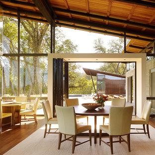 Great room - contemporary medium tone wood floor and beige floor great room idea in San Francisco with gray walls