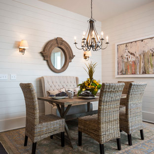Large farmhouse dark wood floor dining room photo in Other with white walls