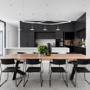 Photo of a large modern kitchen/dining combo in Melbourne with white walls and grey floor.