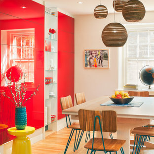 Example of a mid-sized trendy medium tone wood floor dining room design in Philadelphia with red walls and no fireplace