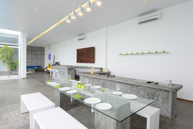 Contemporary Dining Room by Aamir and Hameeda Associates