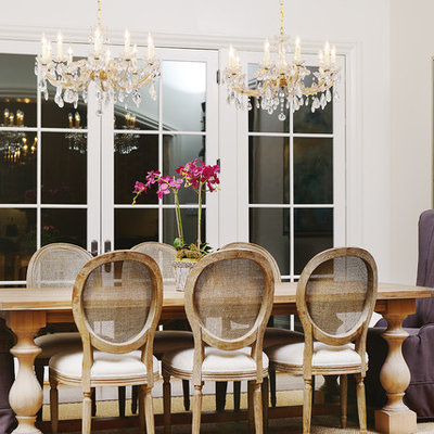 Inspiration for a large timeless medium tone wood floor enclosed dining room remodel in Raleigh with white walls