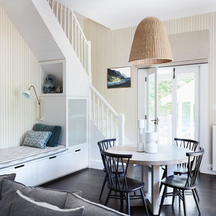Inspiration for a large transitional dining room in Sydney with multi-coloured walls, dark hardwood floors and brown floor.