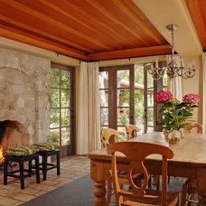 Mediterranean Dining Room by Dixon Construction, Inc.