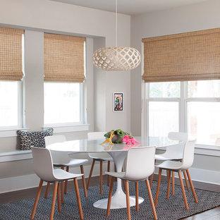 Idées déco pour une salle à manger classique avec un mur beige, un sol en bois brun et un sol orange.