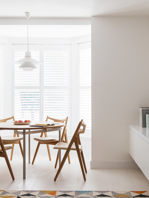 Photo Of A Scandi Dining Room In London With White Walls