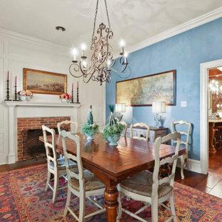 На фото: столовые с синими стенами, паркетным полом среднего тона, стандартным камином, фасадом камина из дерева и коричневым полом