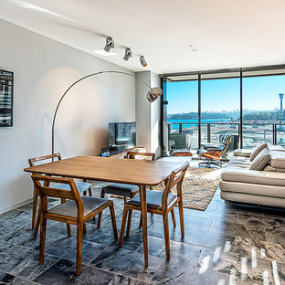Contemporary open plan dining in Hobart with grey walls and no fireplace.
