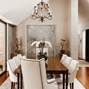 Elegant medium tone wood floor dining room photo in Charlotte with beige walls