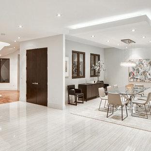 Ispirazione per una grande sala da pranzo minimal con pareti bianche e pavimento in gres porcellanato