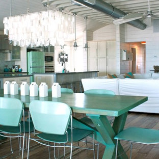 Inspiration for a beach style open plan dining room in Tampa with white walls, medium hardwood flooring and no fireplace.