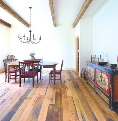 Rustic Dining Room by K.D. Woods Company