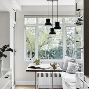 Design ideas for a mid-sized contemporary kitchen/dining combo in Melbourne with grey walls, light hardwood floors and beige floor.