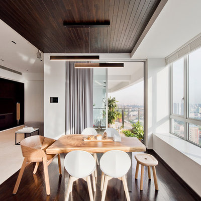 Example of a trendy dark wood floor and brown floor great room design in Singapore with white walls