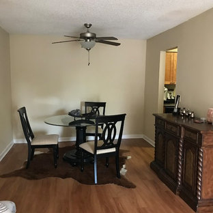 Example of a small cottage chic linoleum floor and brown floor kitchen/dining room combo design in Orlando with beige walls