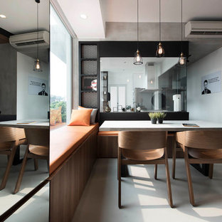 Inspiration for an industrial dining room remodel in Singapore