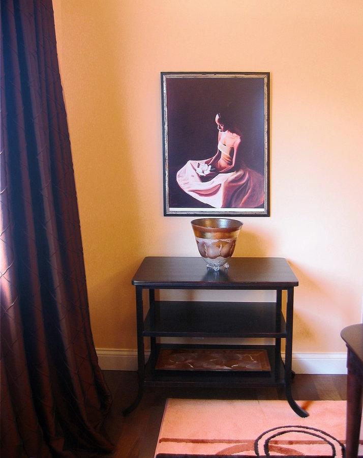 APPEALING ART IN BEAUTIFUL ORANGE DINING ROOM