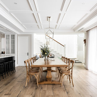 Inspiration for a traditional kitchen/dining combo in Perth with beige walls, medium hardwood floors and brown floor.