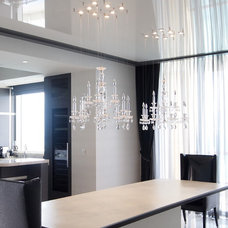 Modern Dining Room by High Tech Ceiling