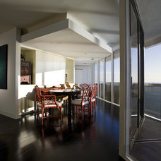 Contemporary Dining Room by Craig Denis