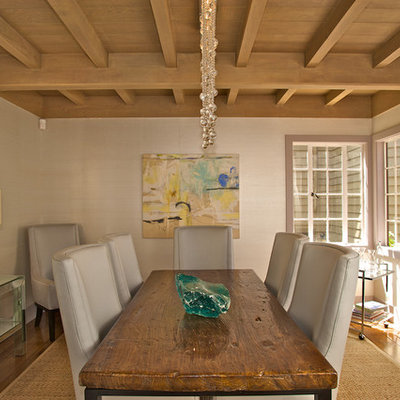 Inspiration for a contemporary medium tone wood floor dining room remodel in San Francisco with beige walls