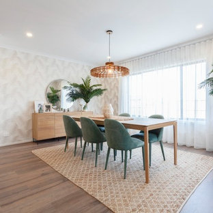 Inspiration for a beach style kitchen/dining combo in Melbourne with beige walls, medium hardwood floors and brown floor.