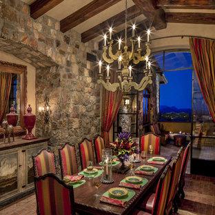 Idée de décoration pour une salle à manger sud-ouest américain fermée et de taille moyenne avec un mur beige, un sol en brique et aucune cheminée.