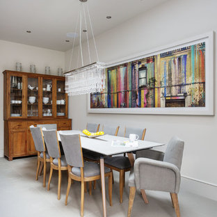 Large transitional white floor kitchen/dining room combo photo in London with white walls