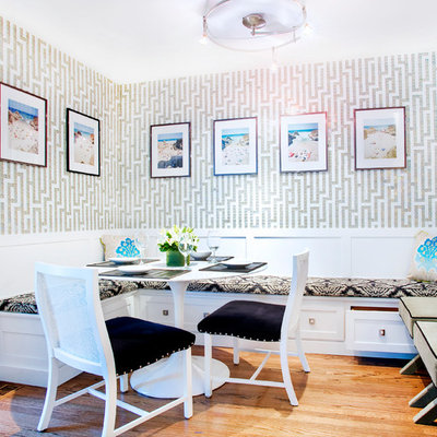 Mid-sized transitional medium tone wood floor kitchen/dining room combo photo in Chicago with multicolored walls and no fireplace