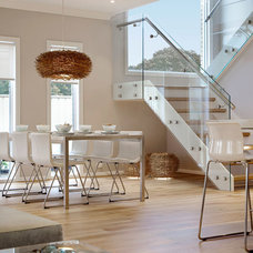 Beach Style Dining Room by Pasco Design