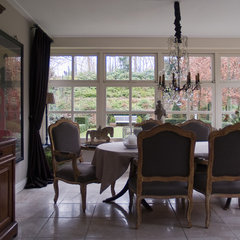 traditional dining room by in3interieur