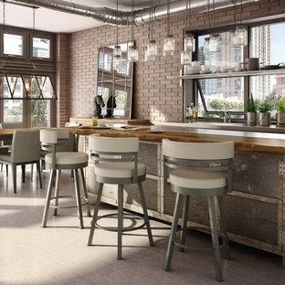 Idee per una sala da pranzo aperta verso il soggiorno industriale di medie dimensioni con pareti rosse, nessun camino, pavimento in cemento e pavimento grigio