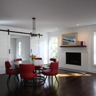 ニューヨークの広いトランジショナルスタイルのおしゃれな独立型ダイニング (白い壁、濃色無垢フローリング、標準型暖炉、レンガの暖炉まわり、茶色い床) の写真