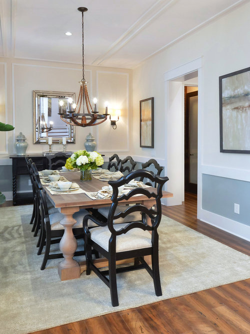 Example Of A Classic Dark Wood Floor Enclosed Dining Room Design In  Charleston With Beige Walls