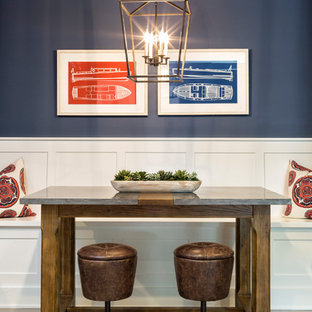 Example of a small coastal gray floor dining room design in Minneapolis with blue walls