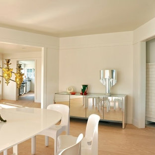 Inspiration for a contemporary medium tone wood floor dining room remodel in New York with white walls