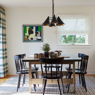 Dining room - large farmhouse medium tone wood floor and brown floor dining room idea in New York with white walls and no fireplace