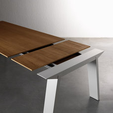 Modern Dining Tables by IQmatics