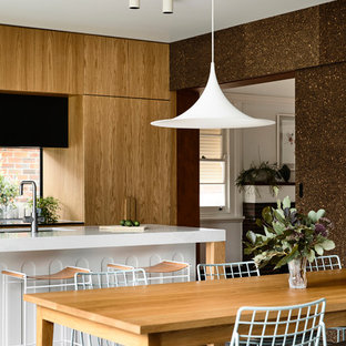 Mid-sized contemporary kitchen/dining combo in Melbourne with concrete floors, grey floor and brown walls.