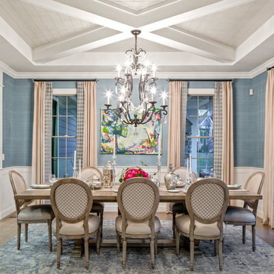 Inspiration for a transitional dark wood floor and brown floor dining room remodel in Cincinnati with blue walls