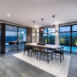 Diseño de comedor de estilo zen, abierto, con paredes blancas y suelo gris