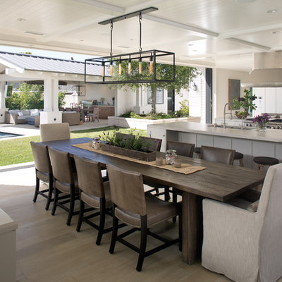 Kitchen/dining room combo - large transitional light wood floor kitchen/dining room combo idea in San Diego with white walls and no fireplace