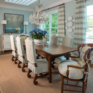 Inspiration for a country dark wood floor dining room remodel in Dallas with blue walls