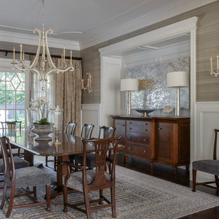 Large classic enclosed dining room in San Francisco with dark hardwood flooring, no fireplace, brown floors and beige walls.