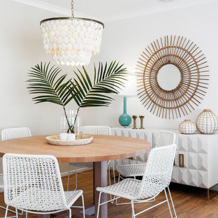 Design ideas for a beach style dining room in Melbourne with white walls, medium hardwood floors and brown floor.
