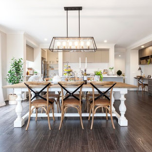 Inspiration for a traditional open plan dining in Melbourne with beige walls, dark hardwood floors and brown floor.