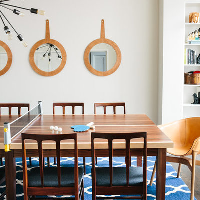 Inspiration for a mid-sized transitional great room remodel in San Francisco with white walls and no fireplace